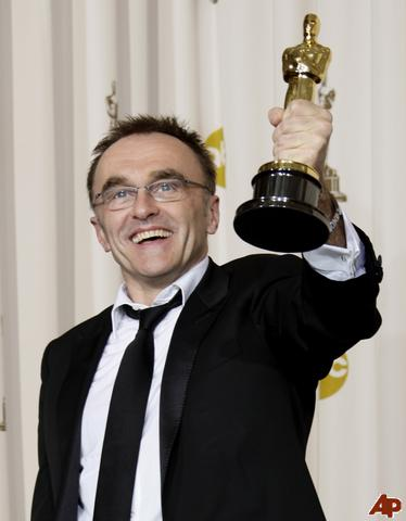 Danny Boyle, director of Slumdog Millionaire, with one of his Oscars